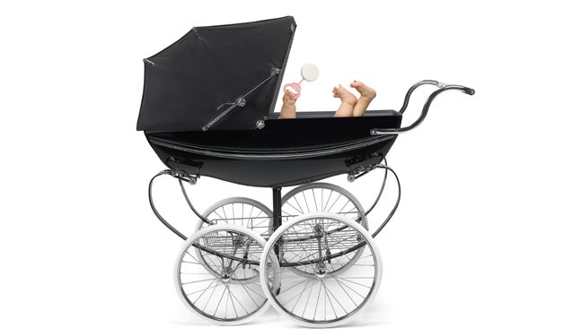 A black baby carriage on a white background