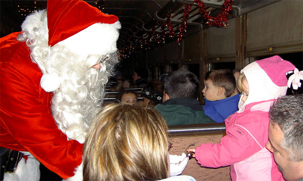 Santa passes out goodies on the holiday express train ride