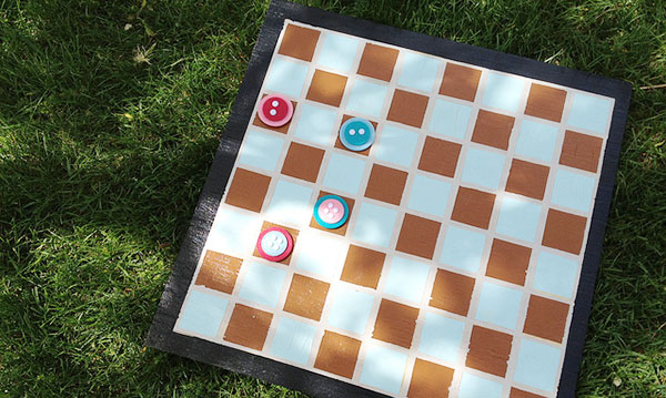 A brown and white checkerboard on a green background