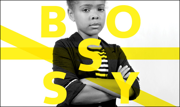 Girl standing with arms folded. The word 'bossy' surrounds her in yellow