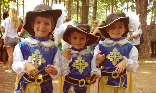 Three kids dressed up for the Michigan Renaissance Festival