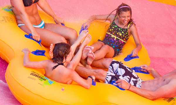 Four people on a waterslide at Michigan's Adventure amusement park