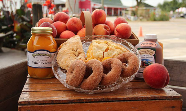 Peach pie, jelly and peaches on a wooden table