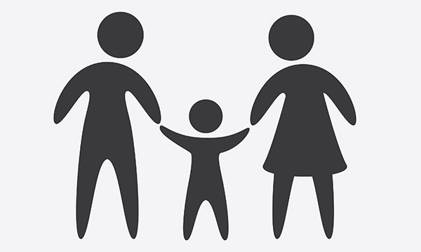 The shadow of a man, woman and child holding hands