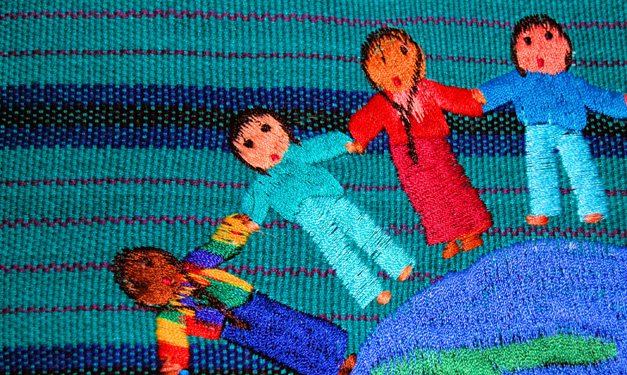 Sewed dolls holding hands