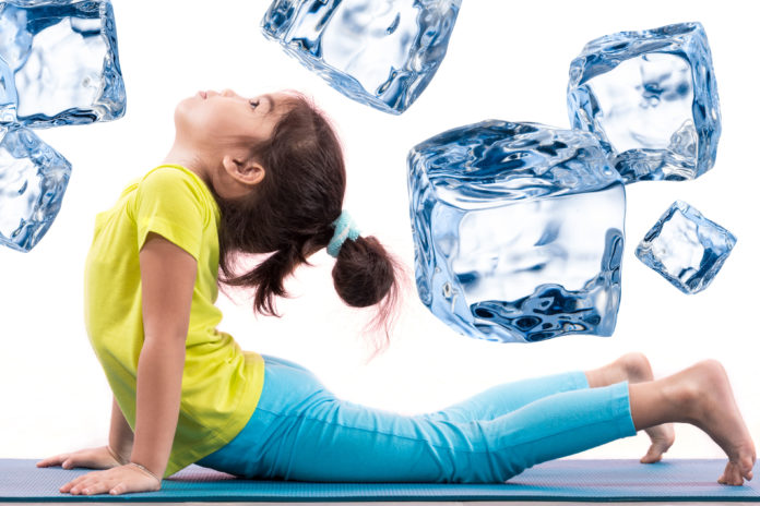 Girl in yoga pose with ice cubes surrounding her