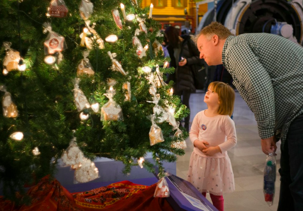 Man and child looking at a Christmas Tree