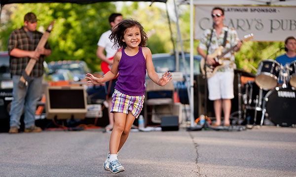 Little girl in purple shirt dancing