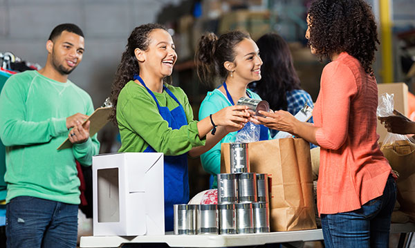 Teens volunteering at a food bank