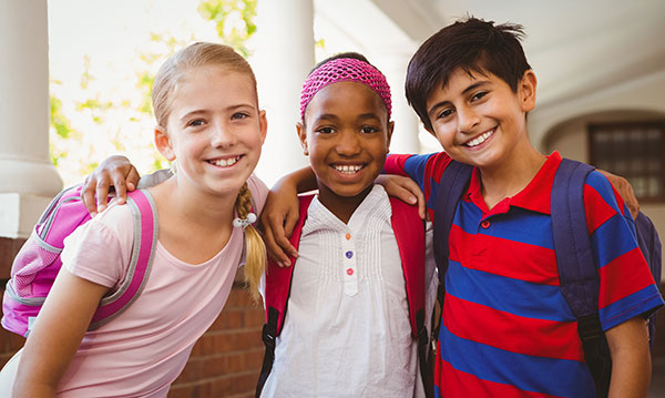 Three elementary-aged kids at school