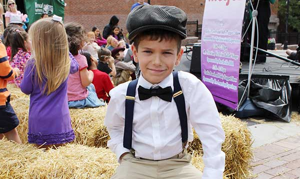 Boy in a victorian costume at the northville heritage festival
