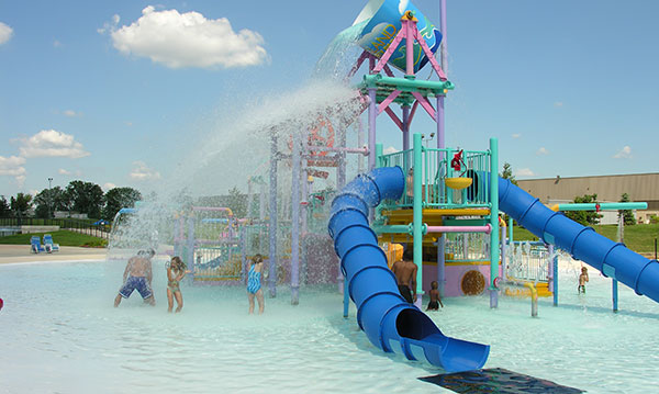 A water play structure in a pool on with a blue sky in the background