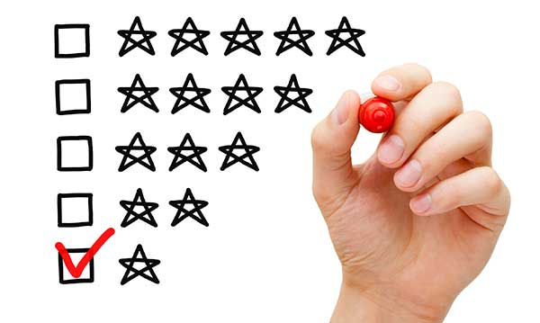 A hand checking one star